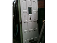Exterior hardwood door with small frosted glass panel