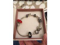 2 Pandora Charm bracelets with 10 charm per bracelet.