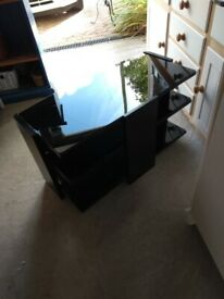 Black glass and steel television stand
