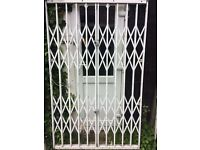 HEAVY DUTY SECURITY GATE, FOR INDOOR OR OUTSIDE USE.