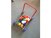 Baby walker and alphabet plastic blocks