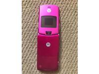 Motorola Raza V3 or O2 X1 mobile phone handset