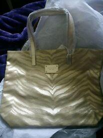 Brand new Michael Kors gold zebra print bag