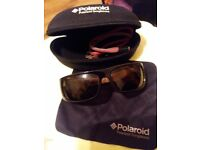 Men's Polaroid Sunglasses with case.