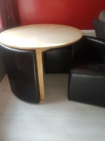 Dining table and chairs in good condition. The chairs fit nicely under the table. £100 ono.
