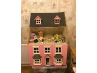 Girls Dolls House with furniture and dolls