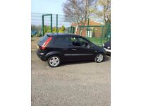 Ford fiesta zetec 1.4 black , all good tyres clean car couple of age related marks , service histo