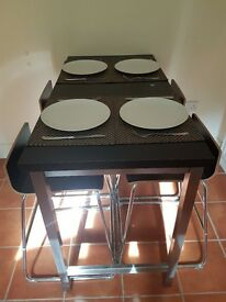 Space saving table and four stools -