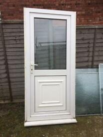 Rear door 910 (could be 970) x 2085 white pvcu, with sill, frosted glass, £70.