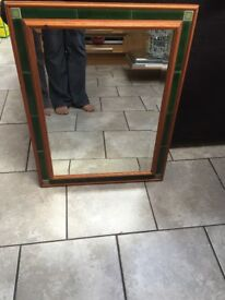 Wooden mirror with green tile surround