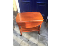 Mahogany Trolley with shelf below and sides that come up to make small table , good condition.
