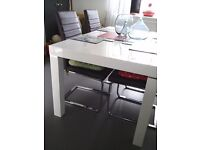 WHITE HIGH-GLOSS DINING TABLE AND FOUR CHAIRS, AS NEW, TOO BIG FOR OUR USE