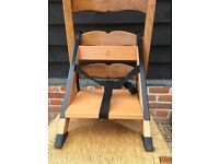 HandySitt portable chair for children that fits to adult seats with HandySitt wipe clean cushion.