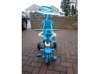 Blue Trike. Almost new. Canope. Safety harness. Kids table and chairs.