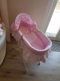 Pink moses basket been used only a few time basicly brand new stand included