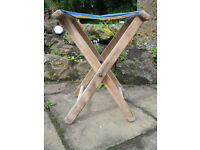 Vintage striped folding wooden stool for garden, fishing or camping.