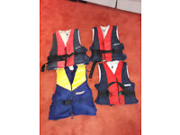 Water skiing starter set: skis, pole, 4 life vests, 2 wetsuits