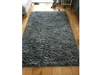 Large grey deep pile rug