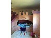 Child's magical castle bed with slide