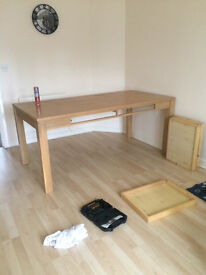 Solid wood dining table, no chairs.