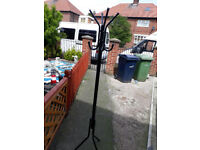 black metal hat and coat stand