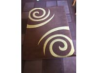 Patterned rug, 47x68inch. A green and brown, cleaned and barely used