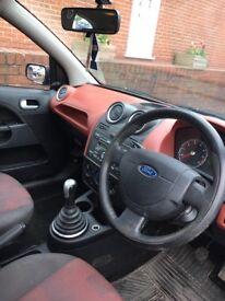 Ford Fiesta zetec 1.25, red interior
