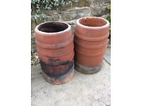 Two matching Vintage terracotta chimney pots.