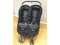 City mini double buggy with rain cover