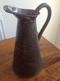 Antique copper jug with snakeskin or crocodile skin pattern