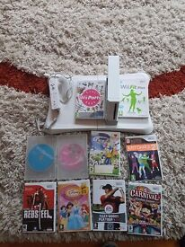 WII fit bundle with 10 games 1 remote controler and wii fit board