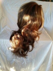 Fabulously styled synthetic long hair wig from top UK supplier. In excellent condition hardly worn.