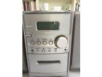 Small JVC stereo, plays cds, tapes, aux port for iPods etc, radio still functioning.
