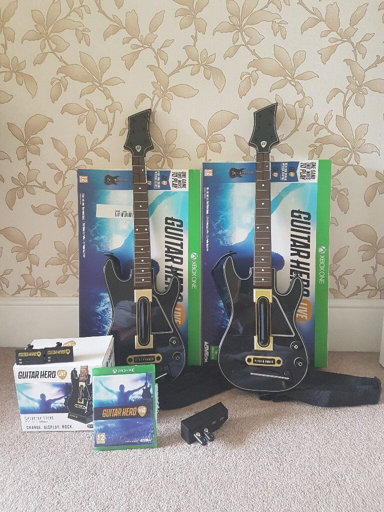 Guitar Hero Live Xbox OneExtrasin Castle Bromwich, West MidlandsGumtree - Guitar Hero Live for Xbox One This bundle includes 2x Guitar Controllers 2x Guitar Battery packs (normally sold separately) 2x Guitar USB receivers Guitar stand which also acts as a charger (normally sold separately) Guitar Hero Live Game for Xbox...