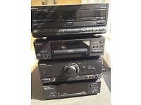 Technics stereo system. CD player, Tuner, double cassette player. Remote control.