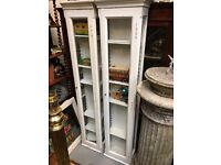 A pair of Edwardian shop display cabinets.