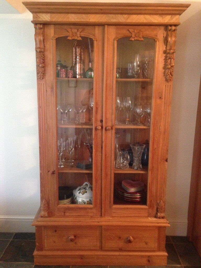 Pine display cabinet, with two glazed doors, decorative carvings on doors with shelving