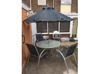 Patio table, 4 chairs and parasol.