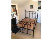 Ornate metal frame bed and mattress