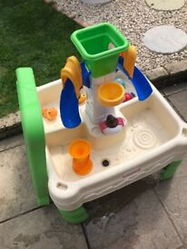 Sand and water play tray. Comes with extra toys and a cover for the sand.