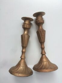 A pair of medium/large antique-effect candlesticks