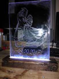 Hand made custom LED etchings on a solid wooden base