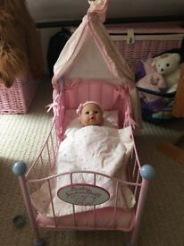 Baby Annabelle cot, bed linen, doll, and doll carrier