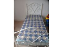 Single love heart bed , white metal frame with mattress . In good condition