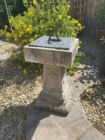 Stone sundial and bench