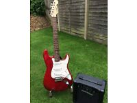 Wine colored Westfield Stratocaster with amp, stand and leads