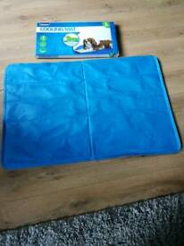 Uncool large dogs cooling mat brand new paid 30.00 fr it aweek ago dogs t scared of it