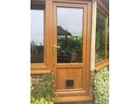 Light oak pvc double glazed door complete with frame and cat flap