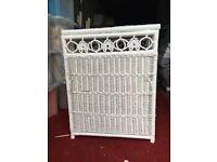 White wicker linen basket