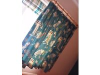 Pale wood curtain pole, Teal coloured curtains & matching cushions with dinosaur theme for kids room